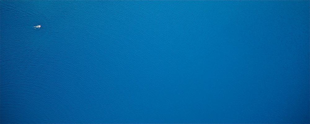 'Molecule', photograph taken by the Blue Lake in Croatia in 2016. Part of minimal series called 'Emptiness & The Blue' that is a study of humans' limited significance in the face of endlessness of space and time.