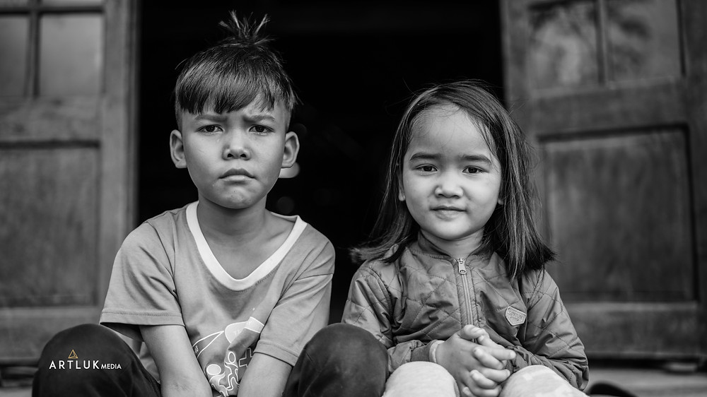 B.Dak Lak Province, Vietnam | Cacao Farm Brother and sister sit on the house steps awaiting their mother to complete the cacao harvest. Cacao is the primary ingredient to produce chocolate.  Let's see if these kids follow in their mothers' footsteps.
