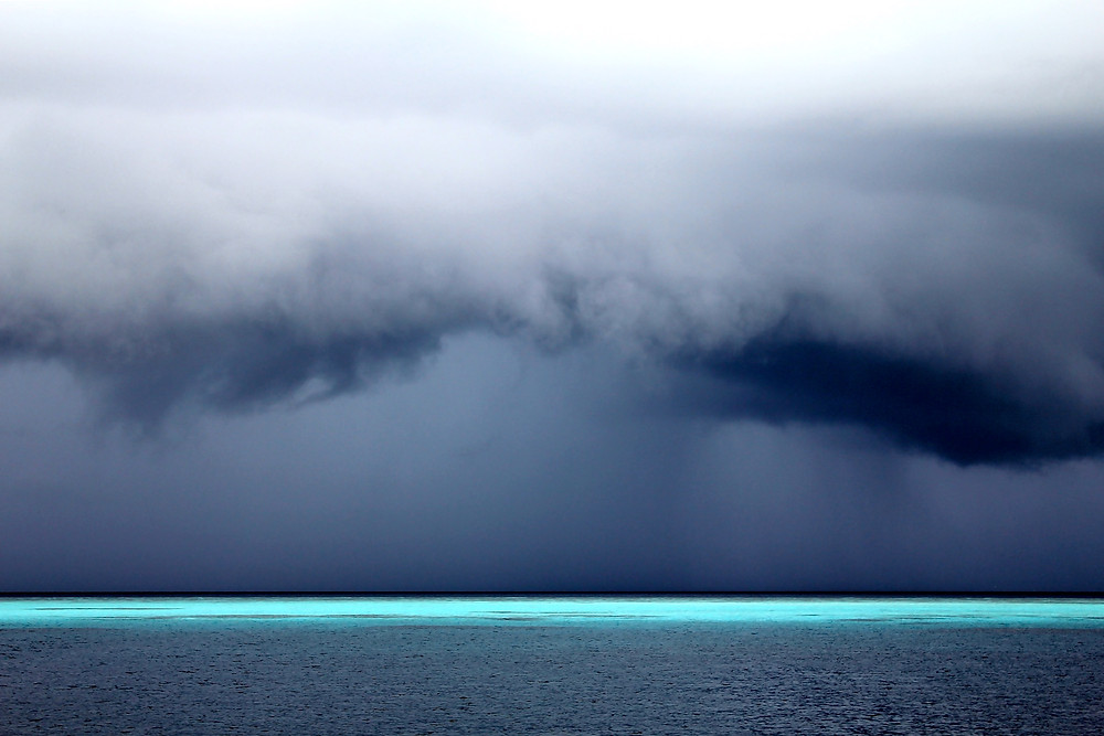 'Thin Blue Line', photograph taken in Maldives in 2010. Photograph shows a reef seen from the boat during a sudden storm on the sea.