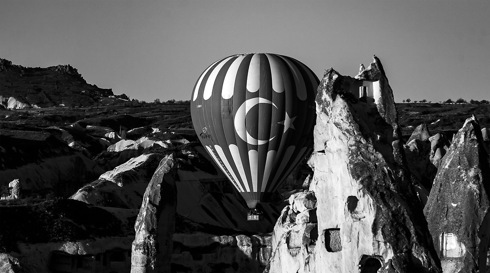 This photo was taken in April 2017. It is of a hot air baloon which is a major tourist attraction for the region. You can see the baloon in the context of fair chimneys which are local rock formations.