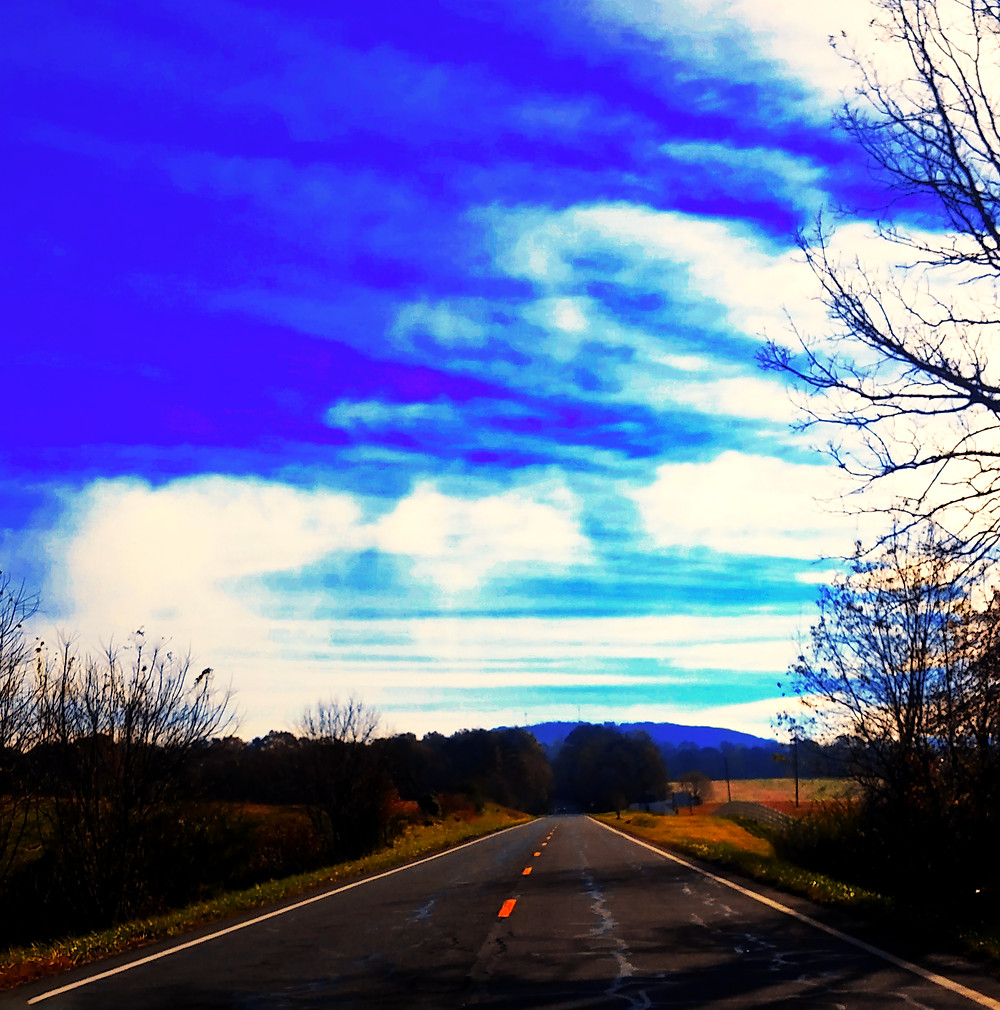 """""""Road"""" was shot on a road trip to Tennessee. Everything was so peaceful and beautiful that I had to pause and capture the vast landscape."""