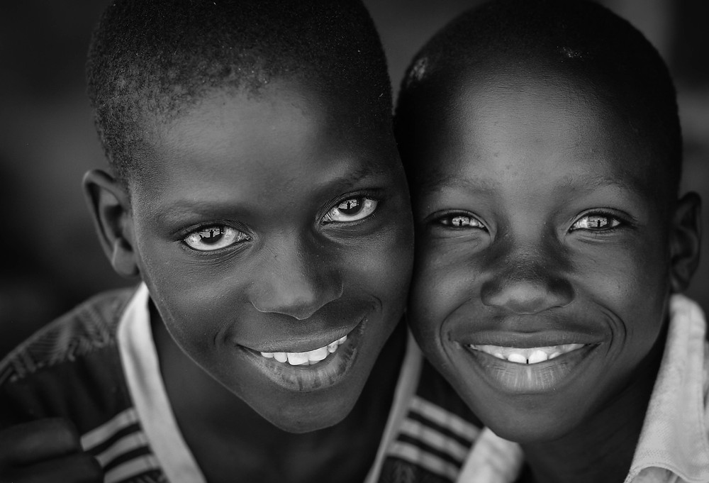 Two joyful friends photographed in a small village on the shore of Cahora Bassa Lake, Mozambique.