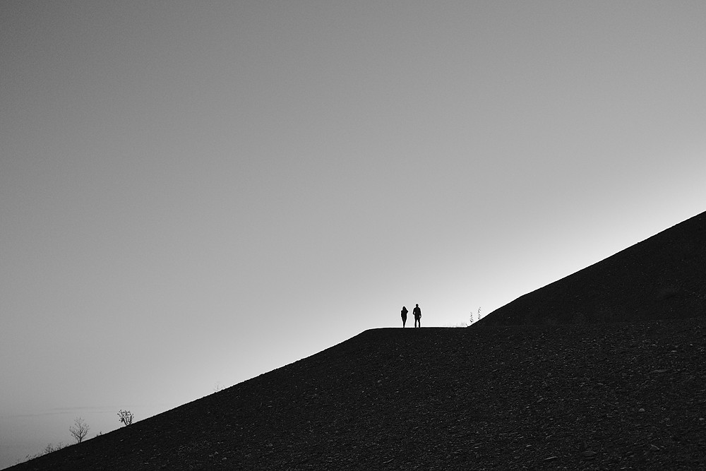 One of my favorite photos. Actually it was a coincidence as I just wanted to capture the silhouette of the hill and didn't pay attention to the couple walking in. Which makes it special though.