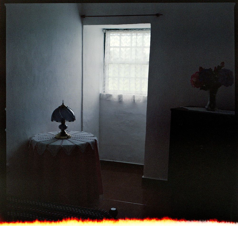 "This image is from my series ""Saudade"", which is an attempt to discover myself through traces of the past within my father's childhood home in Portugal. This image is of my father's childhood bedroom taken on my second visit to Portugal in 2018."