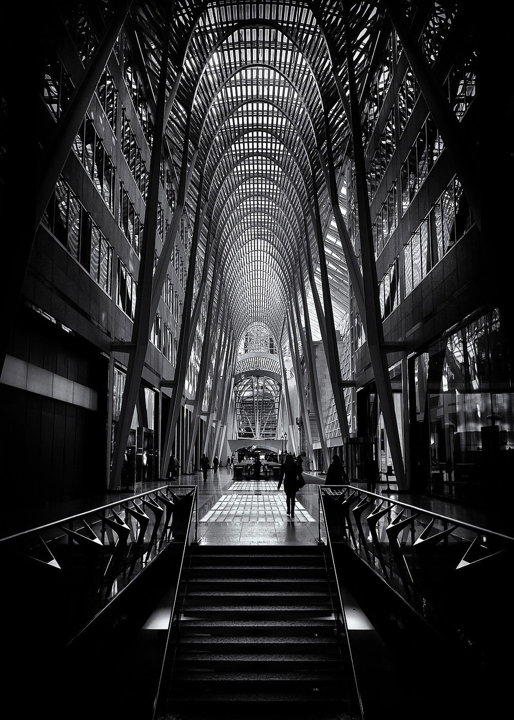 Allen Lambert Galleria  The Allen Lambert Galleria and Heritage Square was constructed after an invited design competition in 1987. The atrium is a six story high pedestrian thoroughfare that connects Bay St to the west and Yonge St to the east in the Toronto Canada financial district and is frequently used as a showcase for major photography and art exhibits.