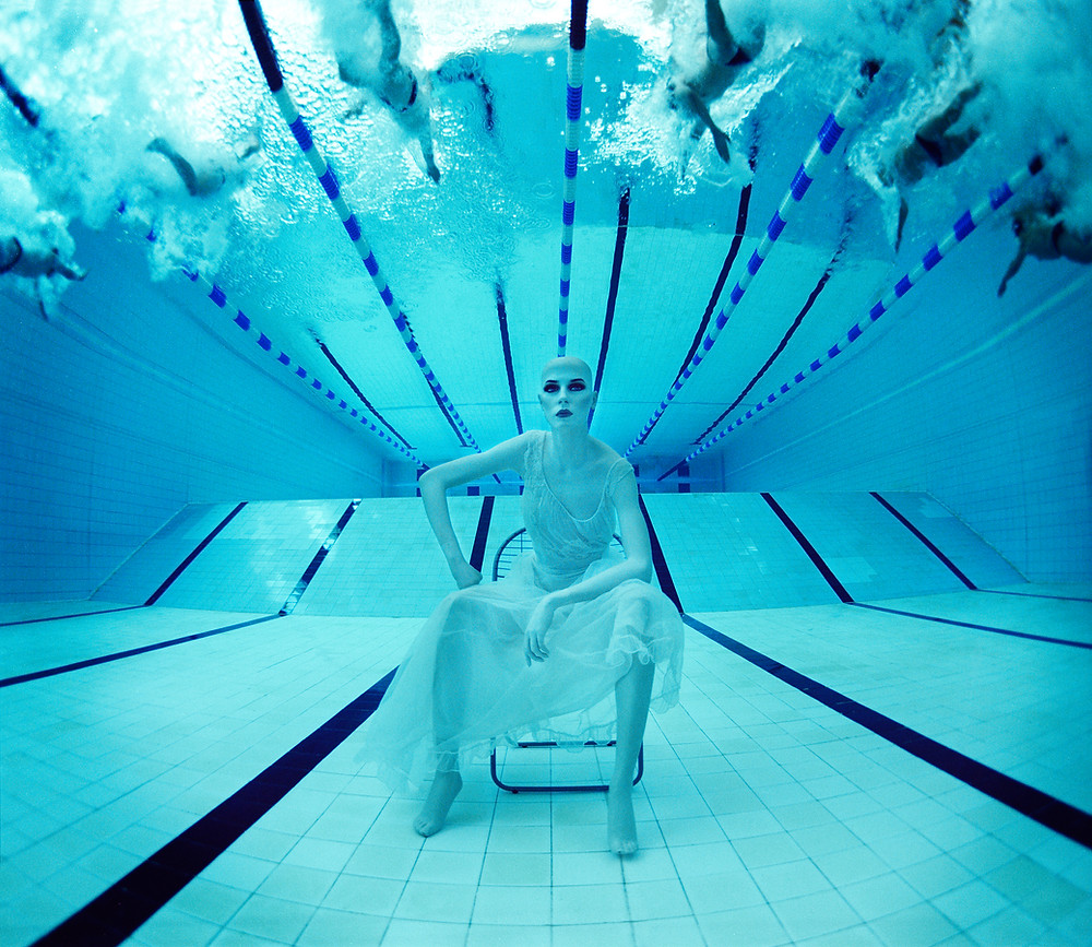 """""""The Endless Search for Quiet Places""""  Mannequin sat on the bottom of St Paul's boys school swimming pool, London 2001.  Photographed on 6x7 film camera."""