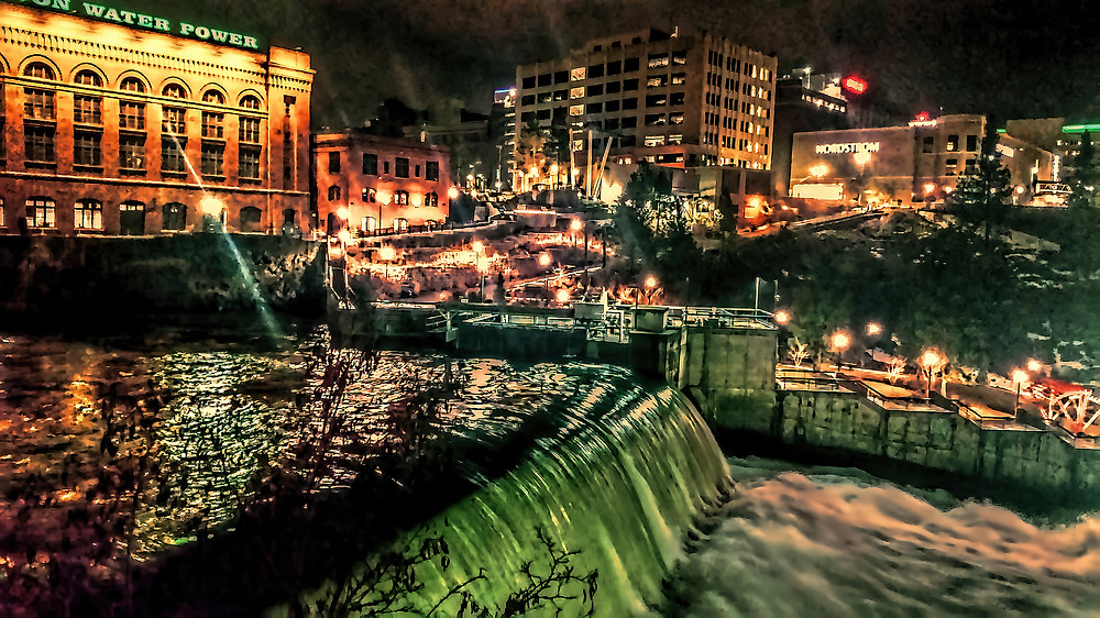 Downtown Spokane at Night: A river runs through it--downtown Spokane, that is. And the river has a series of water falls that take on a magical quality at night.