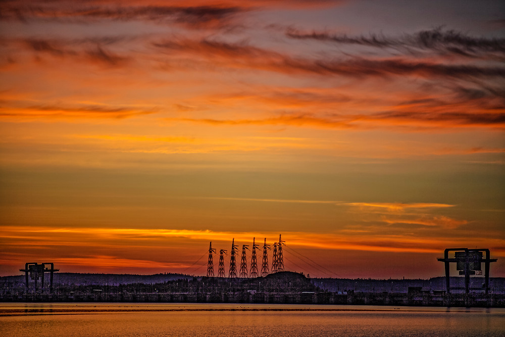 Sunset near Ust'-Ilimsk dam of hydroelectric power station built on Angara river in Siberia.