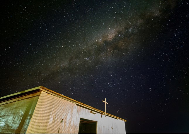 a church and the milky way was captured in Wingellina, a remote Indigenous Community in Western Australia.