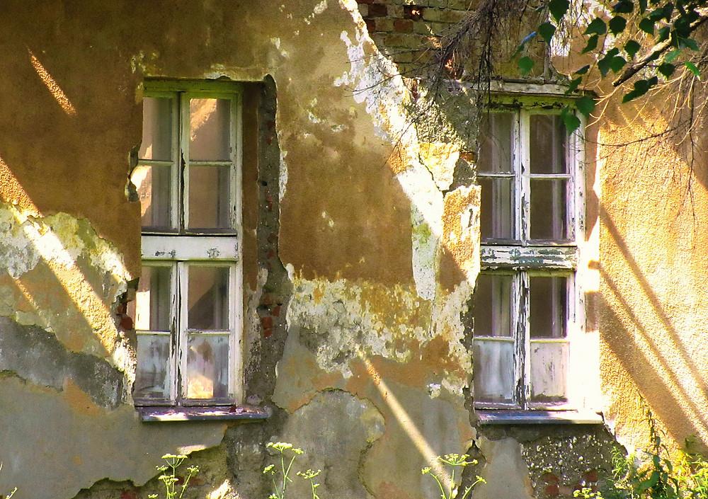 Shadows on abandoned house at noon.