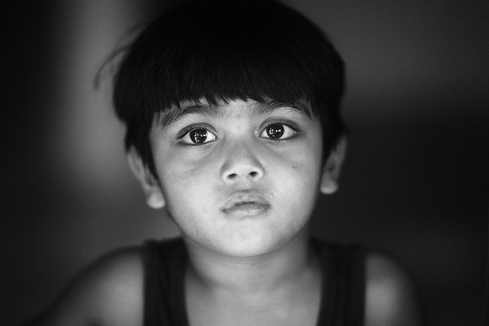 I forced him to pose by our front door, the little man has been unbelievably patient recently. He was really thirsty and wanted to go upstairs to his mother for his water you see....  SOOC.    Rabia Rahman Lane, Chittagong.