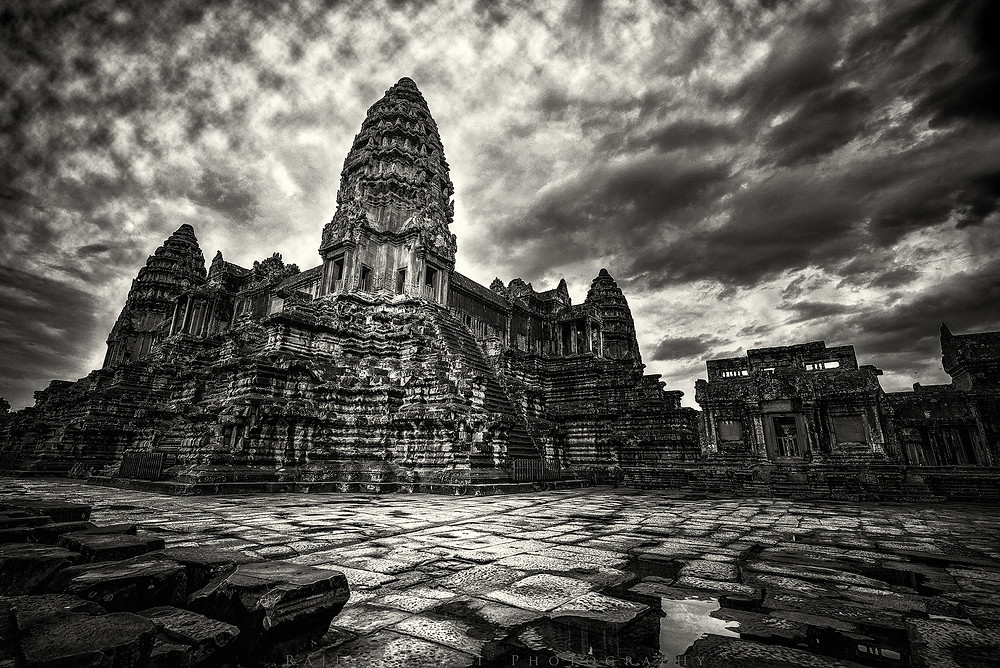 Angkor Wat - Siem Reap is a place caught in the warp of time and rightly so I decided to capture and convert all the images into monochrome which justifies the monuments and surrounding ruins, natural and many made, that have withstood the travails of time and nature. I used a Wide Angle Nikkor lens coupled with a Nikon D810 to capture the image the moment the sun started shining after a heavy downpour.