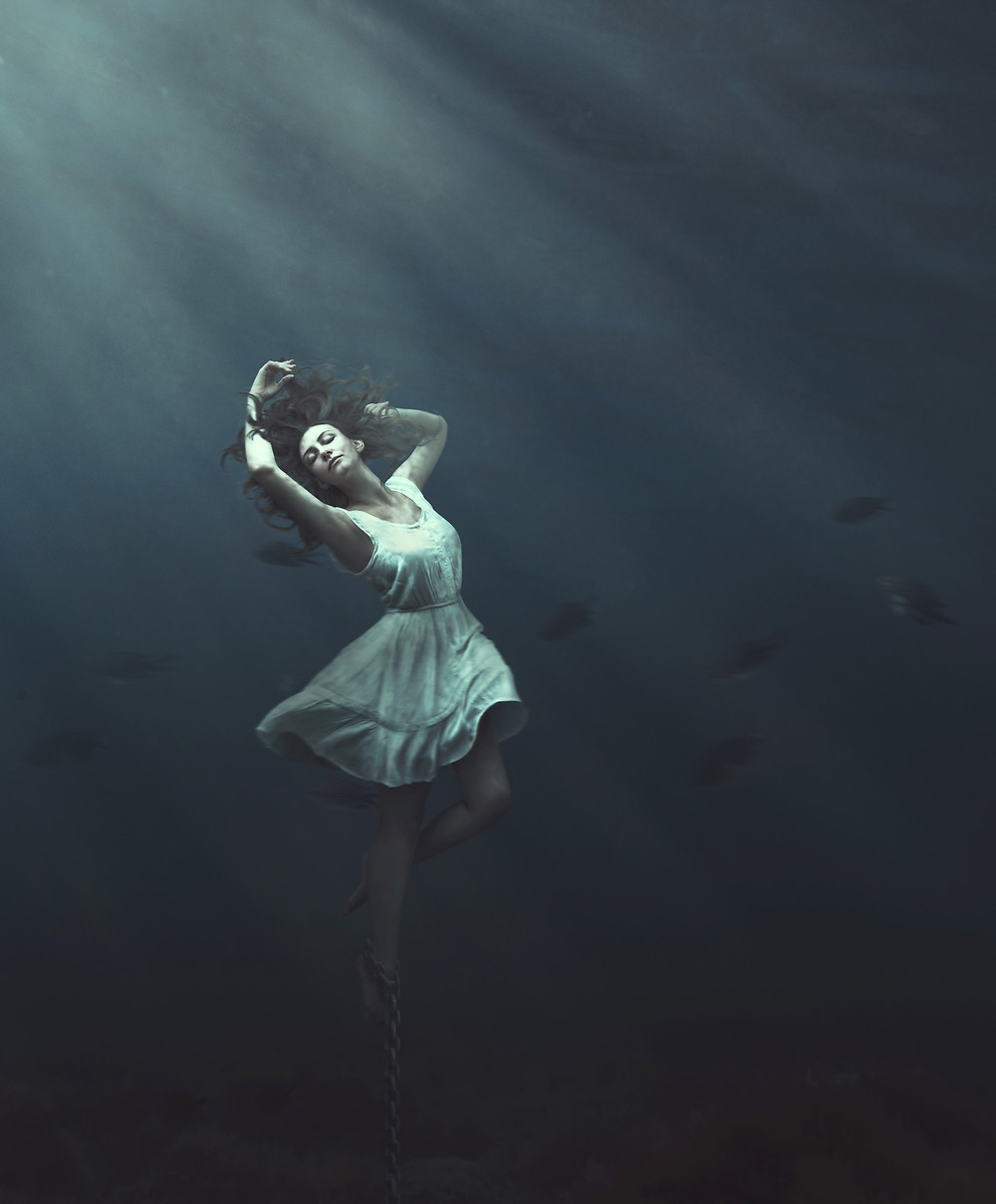 Trapped Underwater  This image is created by a combination of several photos. The girl is photographed in my photo studio and added to my underwater photos. Photographs symbolize reconciliation with imprisonment under water.