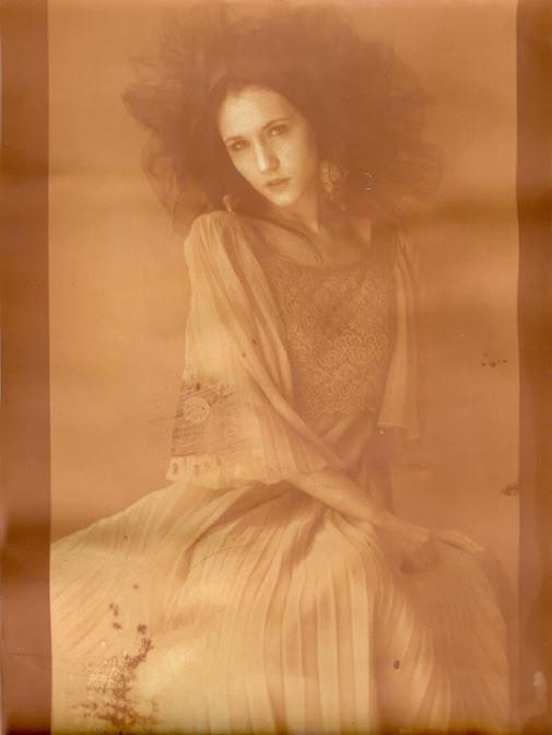 Orange dream: Portrait on old photographic paper. Alternative process called lumen print.