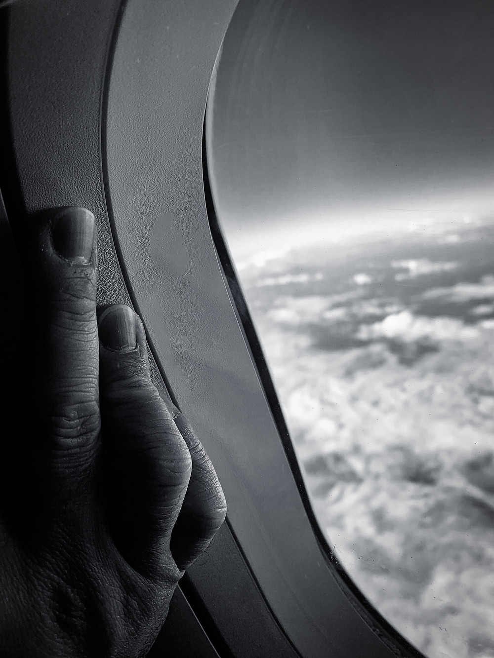 Fear of Flying - I have always been a little afraid of flying, yet I always ask for a window seat. I have been inspired by the book Window Seat by Julianne Kost, who says you should always ask for a window seat if you are a photographer, as the air and the ground will forever bring you numerous opportunities to get great photos. There is also an element of the Twilight Zone on this piece, where you see the tension of the hand holding on to the window...