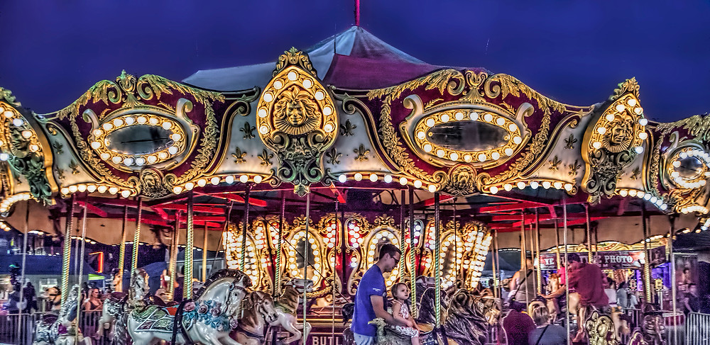 Riding Around (and around and around…): The annual Spokane County Fair brings lots of fun rides, games, and displays for all ages. I love to go there at night to photograph the bright arrays of lights and action.