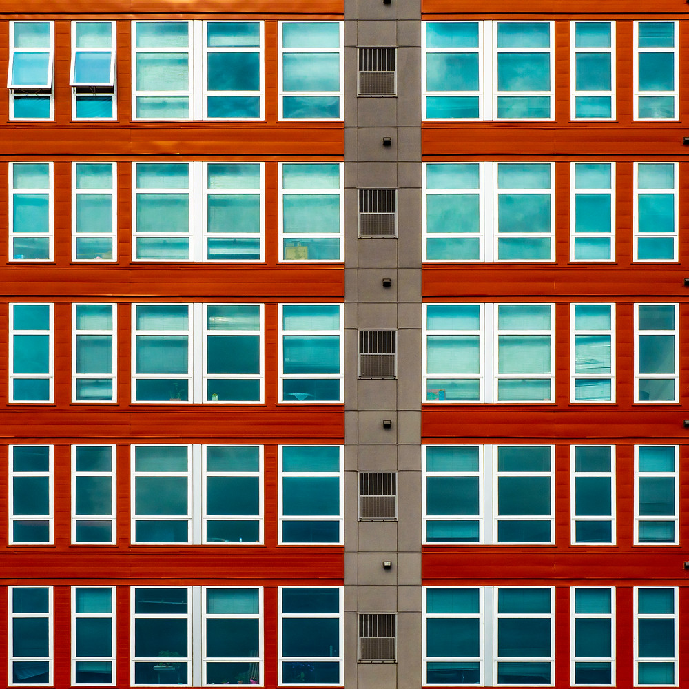 An apartment complex near the University of Minnesota in Minneapolis. I find the interactions between the geometry, the colors, and the reflections of the sky to be fascinating. Taken with a Panasonic G9 and the Olympus 12-100 f4 Pro