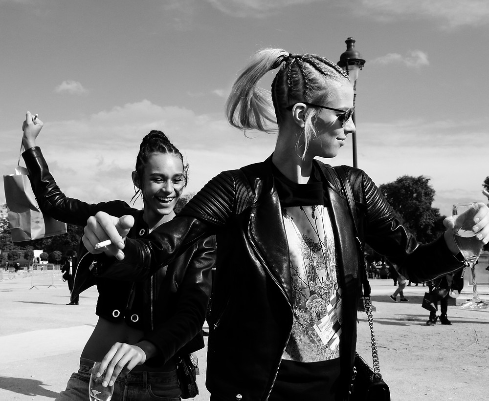 Same  hair,  same  cigarette,  same  leather  jacket,  same  glass  of  champagne,  same  smile,  the  topmodels  twins  Binx  Walton  and  LexiBoling  are  fooling  around  after  a  fashion  show.  Paris,  Tuileries  garden,  fall  2015.