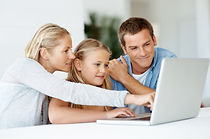 girl-on-computer-with-parents.jpg
