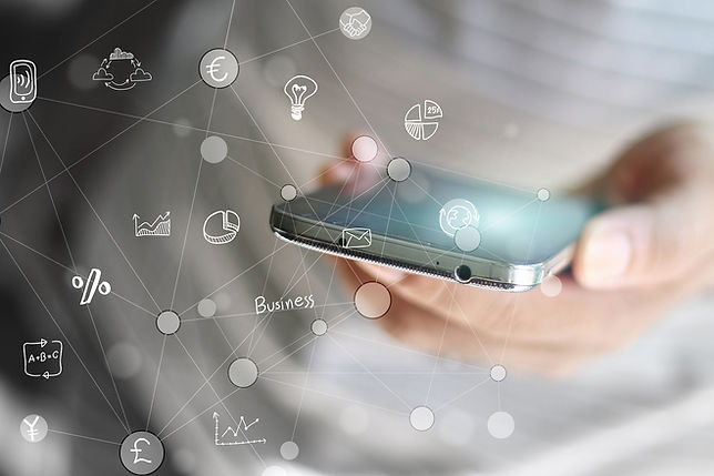 A entrepreneur holding a cellular phone with a matrix of business-relaed images linked to it symbolizing business growth.