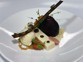 whole poached pear with a panna cotta slice, crumble, vanilla ice cream and chocolate stip decoration at The Church, letterkenny.jpg