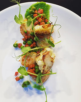 scallops on a bed of fresh vegetables and a pea sauce at the church restaurant, letterkenny