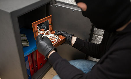 thief-stealing-valuables-from-safe-at-cr