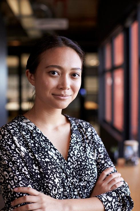 millennial-asian-businesswoman-by-window