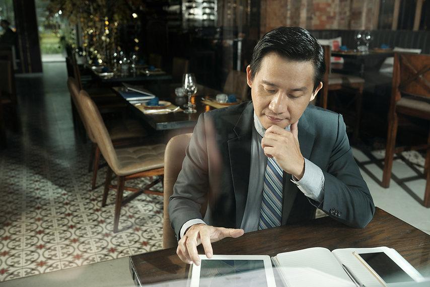 pensive-businessman-4KSSFCC.jpg