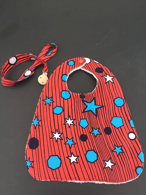 bavoir en tissu africain saumon avec étoiles bleues plus son porte tétine