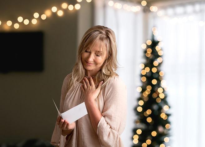 Woman reading a heartfelt message, note,