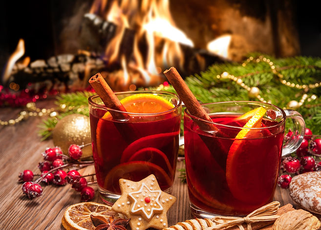 Two glasses of hot mulled wine with chri