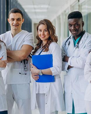 team-of-young-specialist-doctors-standin