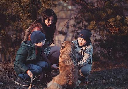 mom, kids, and dog, outside