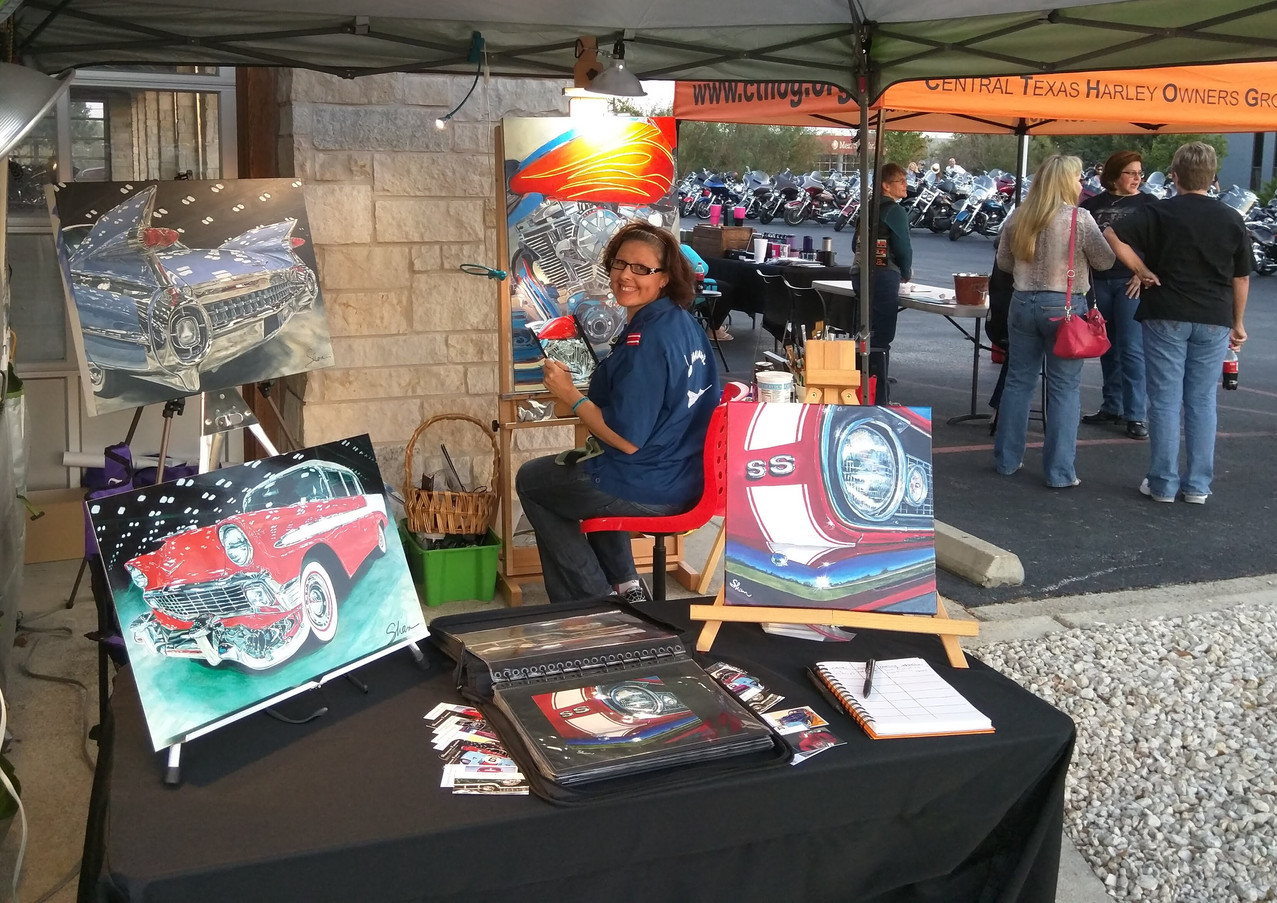 Painting outdoors at Harley festival