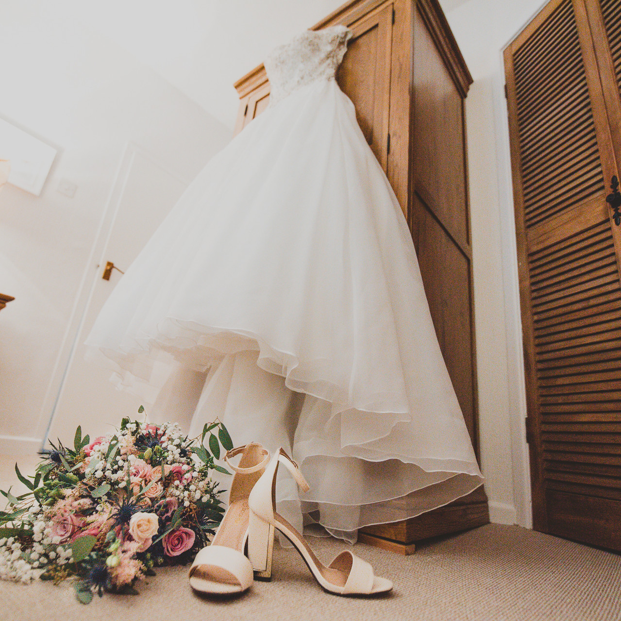Fay Wedding - Thursford Collection at the Garden Pavilion, Norfolk. Wedding Dress and Flowers with shoes