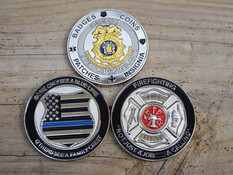 Dual duty coin serves as tribute and business card