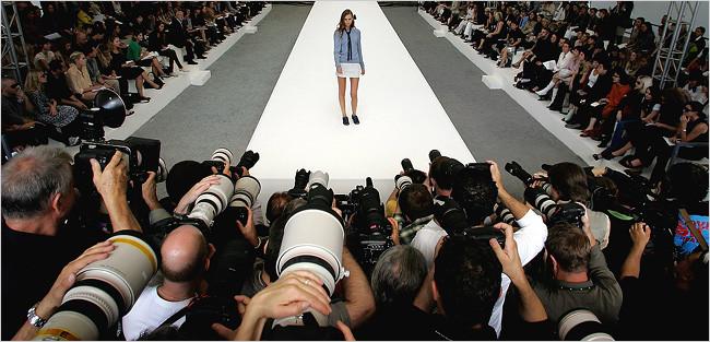 fashion photographers photographing runway model