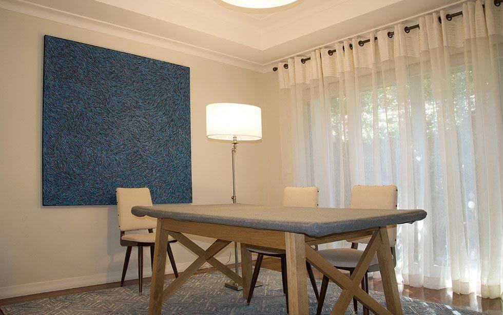 Curtains, Lighting, artwork & rug finish this room