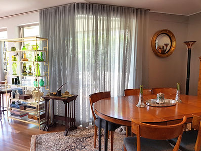 Dining room with sheer curtains