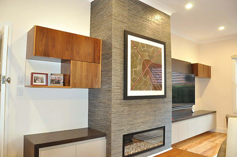 Wall unit with new gas fire place, timberveneer cabinets & Large wall mounted TV.