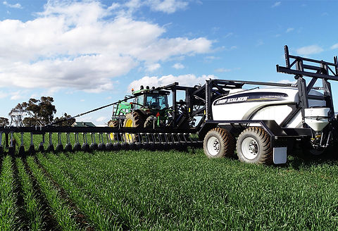 Crop stalker trailed tank unit with shield boom