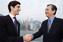 businessmen-shaking-hands-outdoors-two-c