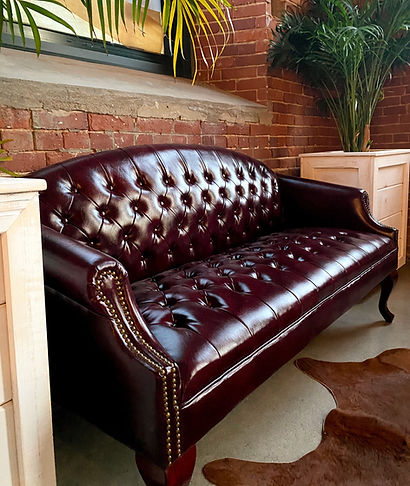 leather couch, palm fronds, exposed brick, cow hide rug, Havana