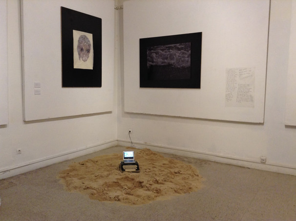 old typewriter with a portable dvd player, playing the performance, and 200 kilos of sand