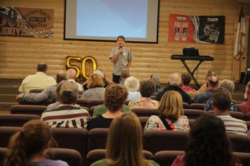 Ken speaking