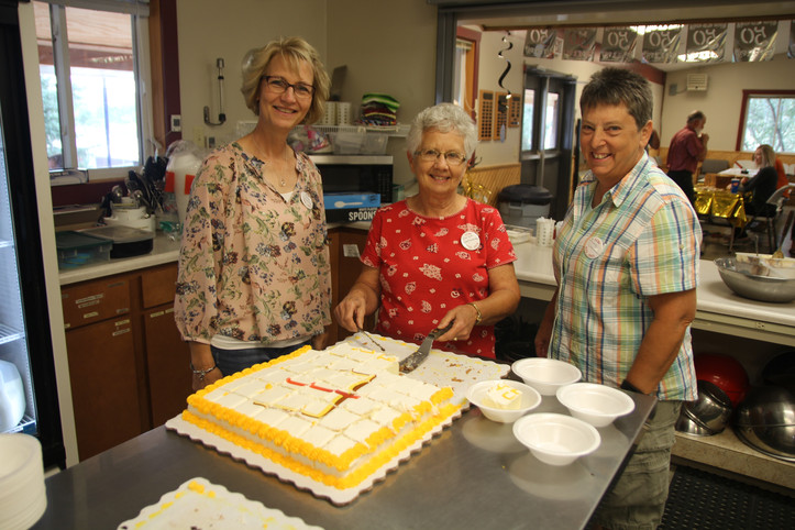 Board members wives serving the cake