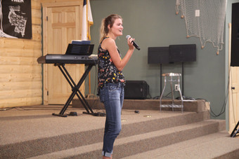 Scout sharing her testimony