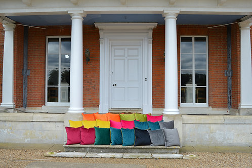 Brightly colored cushions on steps of Earsham Hall