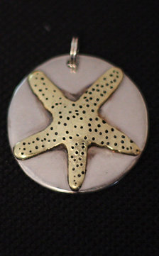 Hand Hammered Coin With dapple Brass Star Fish